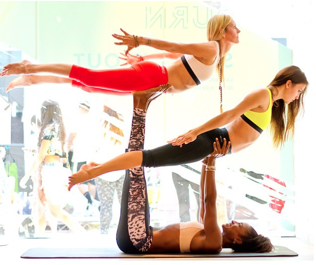 Koya Webb lifts two yogi friends during some acroyoga fun!