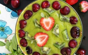Green Smoothie Bowl with Cherries and Strawberry
