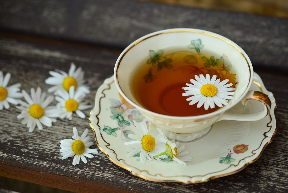 a cup of tea with chamomile flowers