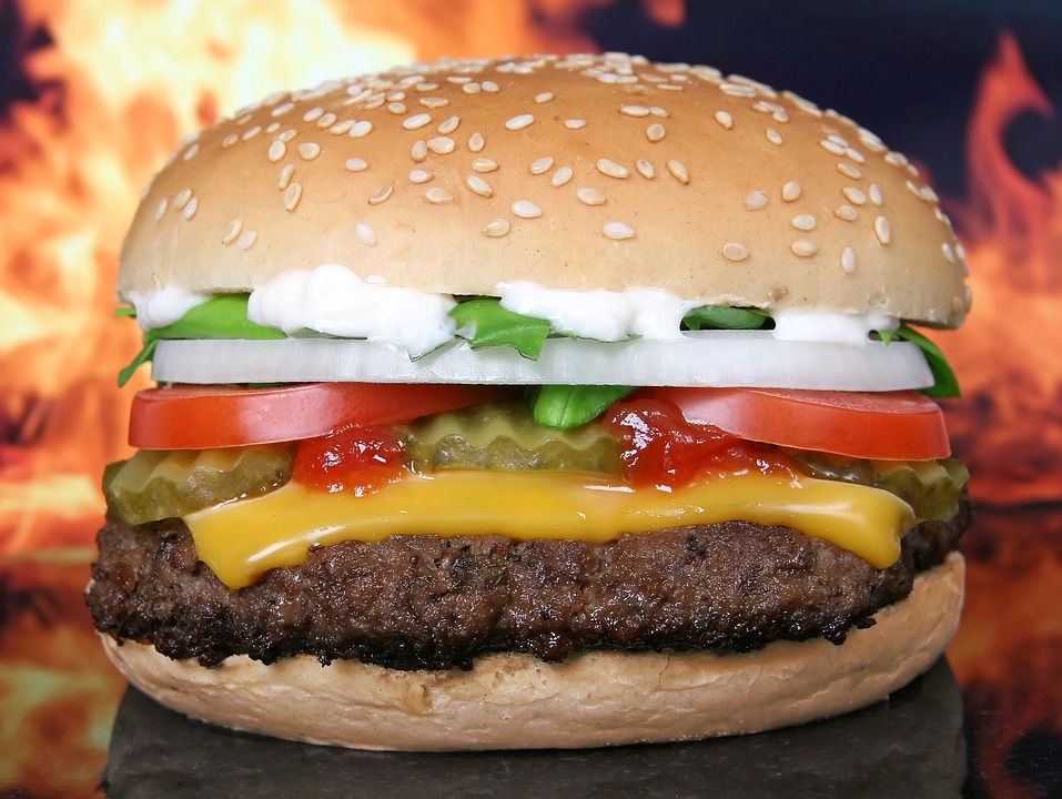 hamburger with cheese, patties and vegetables