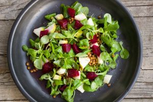 a plate of healthy raw vegetable salad