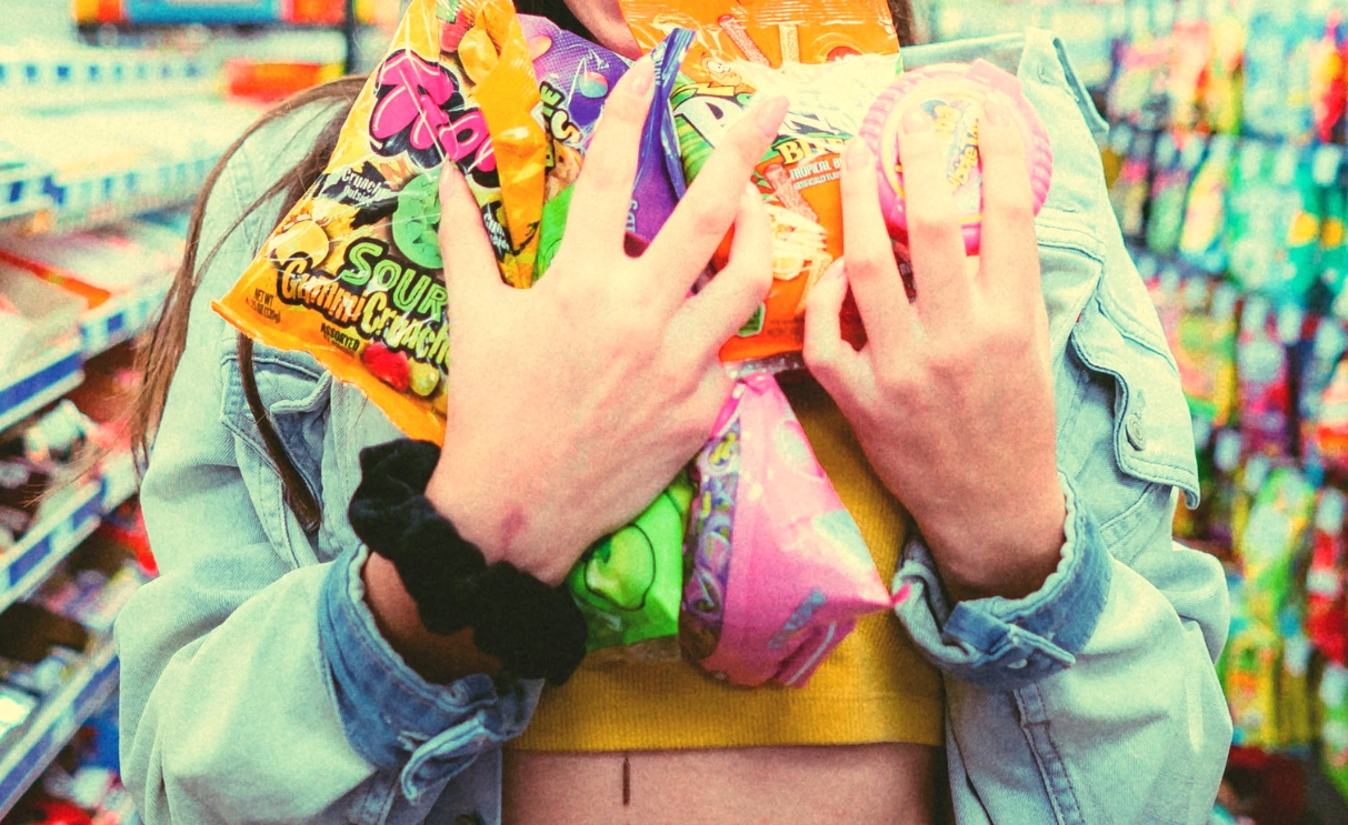 how long does it take to kick sugar addiction, picture of a woman holding bags and bags of candy to her heart
